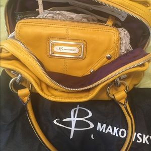B. Makowsky mustard leather purse and wallet